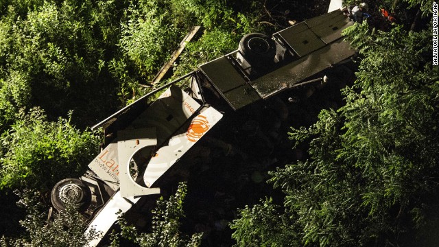The bus lies on its side after plummeting off the bridge on Sunday, July 28.