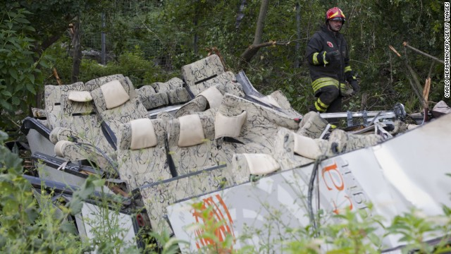 A firefighter inspects the wreckage on July 29.