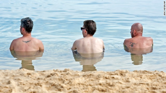 Men relax at a lake near Erfurt, Germany, on Sunday, July 28.