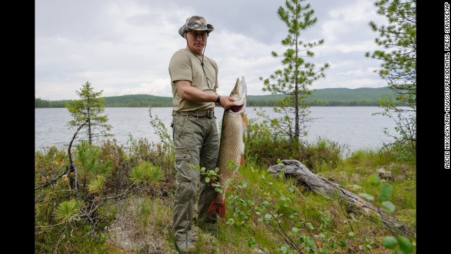 Russian President Vladimir Putin holds a pike he caught in the Siberian Tuva region of Russia on July 20. Browse through for more photos of Putin trying his hand at different activities.