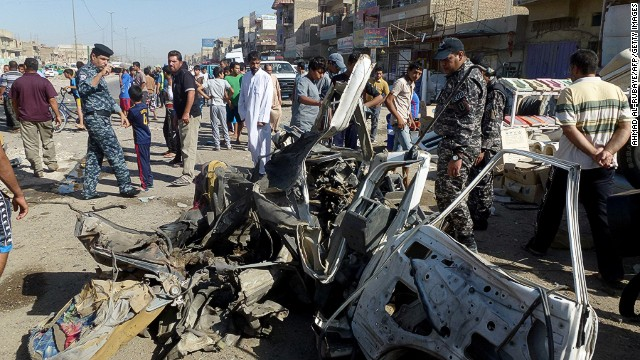 Rubble lies in a street after a car bomb explosion in Sadr City, Baghdad, on Monday.