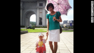 Occasionally, the mask slipped to show a more poignant, human face of the isolated nation. Here a young mother and her child pose for Watson while walking in Pyongyang.