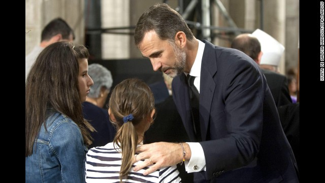 Prince Felipe expresses his condolences to a family of the victims of the train accident during the funeral July 29.