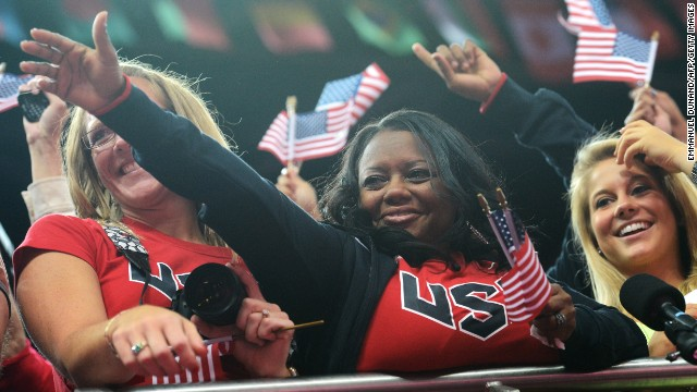 Her mother Natalie Hawkins was left crying tears of joy after watching the teen win two gold medals at the London 2012 Olympics. Hawkins is pictured with Missy Parton (left) -- the mother of Gabby's host family while training in Iowa.