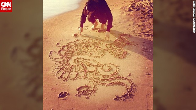 "In this photo Farrah Azam can be seen drawing one of her henna designs in the sand at a beach in Antalya, Turkey. The 26-year-old <a href='http://statigr.am/viewer.php#/user/254704119/' target='_blank'>henna artist from London</a> creates bespoke designs but unusually she paints it on canvases and other objects rather than on body parts. <!-- --> </br><!-- --> </br>""I am a practicing Muslim who participates in the month of fasting. Eid marks the end of the month of fasting and I celebrate it with my family and friends by visiting the mosque for the special Eid prayer, having a lavish meal, exchanging gifts and meeting relatives,"" she said."