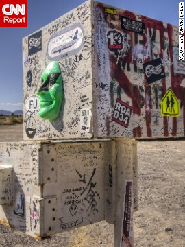 This interesting mailbox marks the dirt road that presumably leads to the legendary Area 51. Throughout the years, tourists and alien-seekers have decorated it with stickers, graffiti and even a green face.