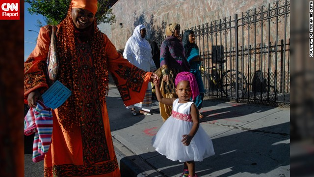 """There are four mosques in the immediate neighborhood and each one celebrates Eid slightly differently,"" said Stephanie Keith from Bedford-Stuyvesant, a part of <a href='http://ireport.cnn.com/docs/DOC-1010042' target='_blank'>Brooklyn</a> that has become a popular area for African immigrants. ""One mosque has the street blocked off during prayer time and all the worshippers fill the streets. Another mosque blocks off the street for the whole day and has a street party. But at every mosque, people don their fanciest outfit of the year most in an African style,"" said the 47-year-old travel journalist who used to live and work in Egypt."
