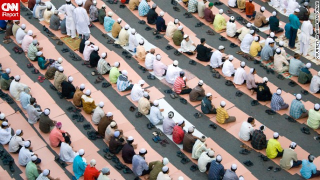 "Anupama Kinagi, 37, shot this photo of Muslims in prayer from a terrace near the Hamidiya Masjid mosque in <a href='http://ireport.cnn.com/docs/DOC-1012390' target='_blank'>Mumbai, India</a>. He said he wanted to capture the geometric pattern formed by so many bowed heads and bodies: ""It was a beautiful morning. The sky was clear. There were hundreds of men gathered to prayer as a ritual. The men were dressed in Kurta Pajama. The place was noisy but as soon as the prayers started it was so peaceful and pin drop silence. After the prayers everyone hugged and greeted each other 'Eid Mubarak'."""