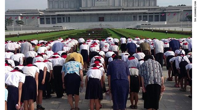 Schoolchildren paid their respects at Kumsusang Palace of the Sun, where Kim Il Sung and Kim Jong Il lie in state in glass coffins.