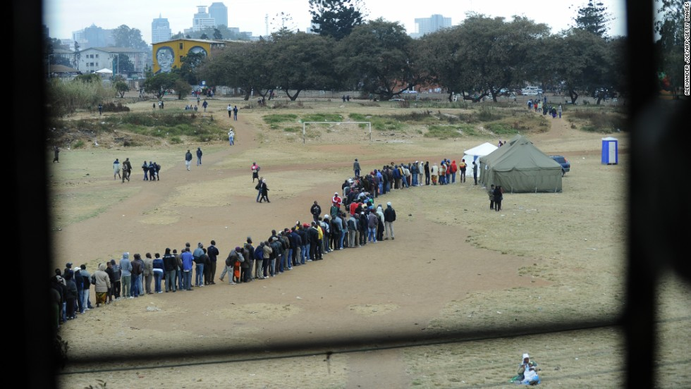 July 31 - Harare, Zimbabwe: People line up to <a href='http://cnn.com/2013/07/31/world/africa/zimbabwe-election/index.html?hpt=hp_t1'>vote in general elections</a>, as President Robert Mugabe seeks to extend his time in power to a potential 38 years. Mugabe, 89, has been in charge of the country since 1980 -- the only leader the nation has known since it gained independence. His main rival, Morgan Tsvangirai, is the current prime minister.