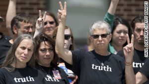 Bradley Manning supporters make peace signs after the Manning verdict was announced July 30.