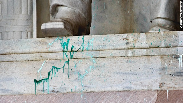 Green paint is splattered on the base of the statue on July 26.