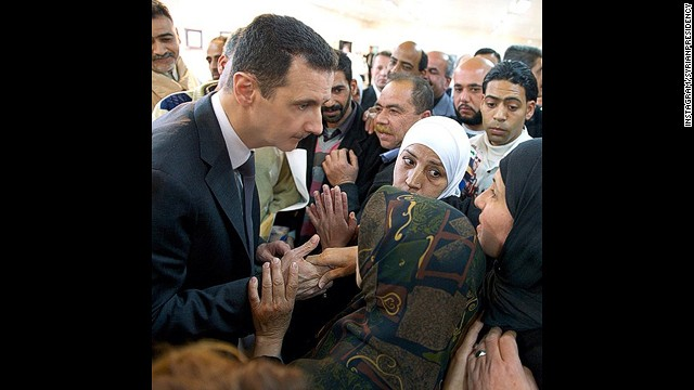On his new Instagram account, Syria's President Bashar al-Assad is seen greeting and listening intently to a group of women.