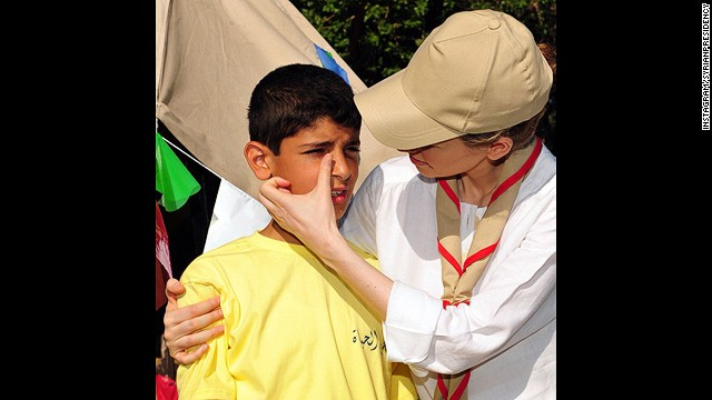 The President's wife, Asma al-Assad, wipes away a tear on a boy's face. The embattled president announced he was adding Instagram to his social media blitz last week via a message posted to his Twitter account.