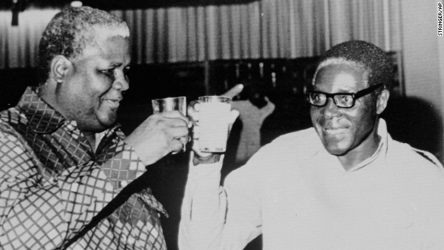 Joshua Nkomo, founder of the Zimbabwe African People's Union, and Mugabe have a drink in 1978.