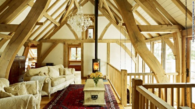 Rob and Alithea designed the house themselves, drawing inspiration from magazines and DIY home exhibitions. Their vaulted living space upstairs looks out into the surrounding forests. For more photos visit the <a href='http://www.homebuilding.co.uk' target='_blank'>home building</a> website.