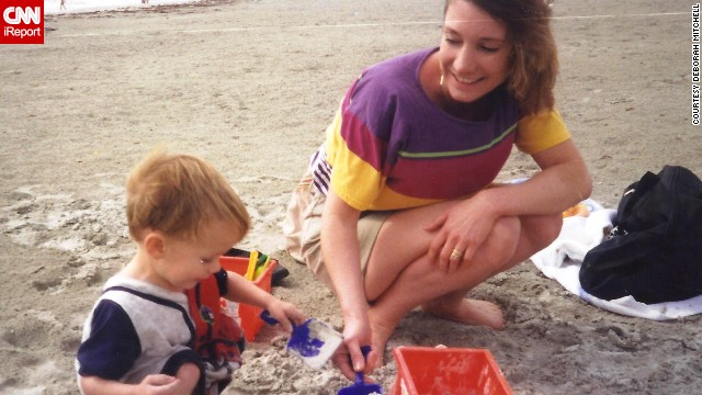 """Watching you learn and grow has been one of the greatest experiences of my life,"" Mitchell wrote to her son, shown here at 13 months."