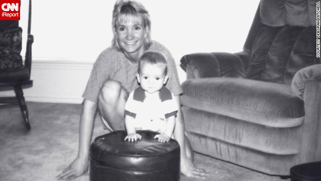 """The prize is here, now. In every breath you take, every new friend, every kiss, every challenge, every exciting piece of information you discover,"" Mitchell wrote to her son. Here, she poses with Nick when he was 6 months old. <!-- --> </br>"
