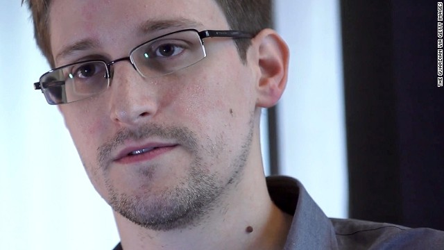Edward Snowden, the man who leaked top-secret details about U.S. surveillance programs, has been charged with three felony counts, including violations of the U.S. Espionage Act. After living in a Moscow airport since June, he began his <a href='http://www.cnn.com/2013/08/01/us/nsa-snowden/index.html'>temporary asylum in Russia</a> in August 2013. He had been hiding out in Hong Kong until WikiLeaks helped him move to Moscow. Snowden has said he is afraid he would not get a fair trial if he came back to the United States.