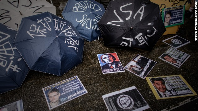 Umbrellas with slogans are lined up before a Hong Kong march to the US consulate in support of NSA leaker Edward Snowden.