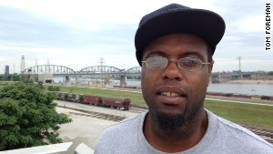 Vernon Glenn, 27, works in a factory, and says saving all he can is his strategy for economic survival.