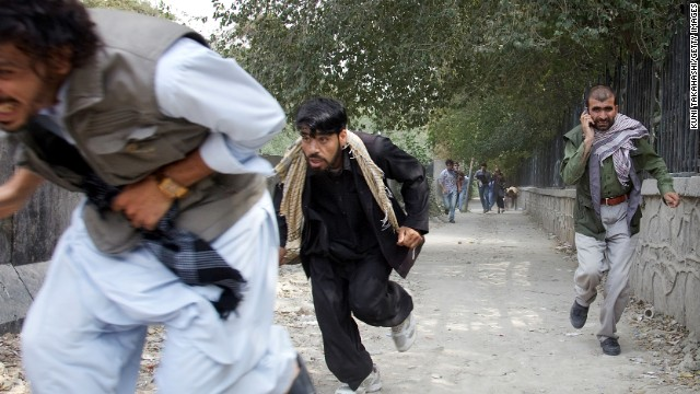 People flee the scene of a Taliban attack on the U.S. Embassy in Kabul, Afghanistan, on September 13, 2011. Three police officers and one civilian were killed. There were no reports of U.S. casualties.