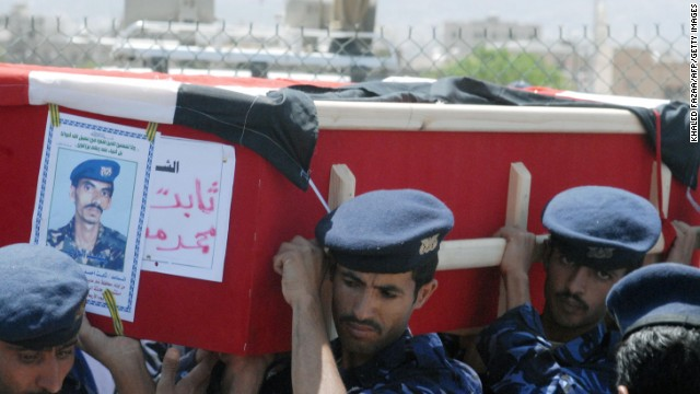 Yemeni soldiers carry the coffin of a comrade during a funeral on September 25, 2008, in Sanaa. Heavily armed fighters attacked the <a href='http://www.cnn.com/2008/WORLD/meast/09/17/yemen.blast/index.html'>U.S. Embassy in Yemen</a> on September 17. A car bomb was detonated, killing 10 Yemeni police and civilians and six attackers.