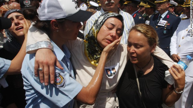 "Relatives of slain police officers are comforted during a funeral in Istanbul, Turkey, on July 10, 2008, a day after the U.S. Consulate there was attacked. Three police officers and three attackers were killed in what the American ambassador to the country called ""an obvious act of terrorism"" aimed at the U.S."