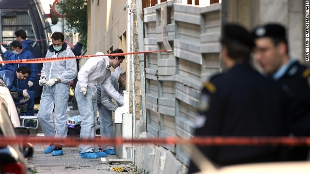 A bomb squad team collects evidence at a construction site where a rocket was launched near the <a href='http://www.time.com/time/world/article/0,8599,1577262,00.html#ixzz1XpywafjU' target='_blank'>U.S. Embassy in Athens, Greece,</a> on January 12, 2007. The anti-tank missile tore through the embassy, but there were no injuries.