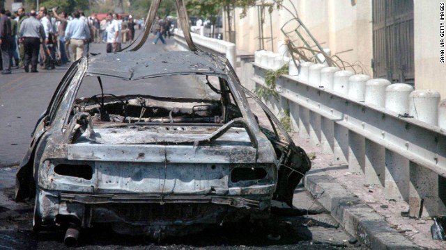 A car exploded near the U.S. Embassy in Damascus, Syria, on September 12, 2006. Fourteen people were wounded. Syrian authorities killed three attackers and apprehended a suspect outside the building.