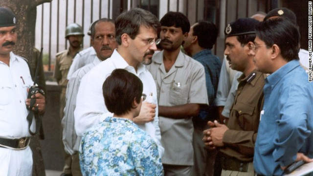 Christopher Sandrolini, the U.S. consul general in Calcutta, speaks with Indian officials outside the <a href='http://news.bbc.co.uk/2/hi/south_asia/1774483.stm' target='_blank'>U.S. government information center in Calcutta</a>, near the U.S. Consulate, where heavily armed gunmen killed five Indian police officers on January 22, 2002.
