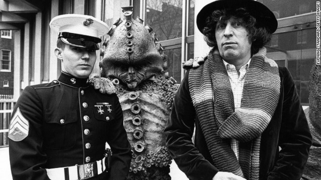 The fourth Doctor, played by Tom Baker from 1974-1981, standing alongside a Zygon, meets Sergeant Frank Ziegler, a guard at the American Embassy in Grosvenor Square, London in 1978.