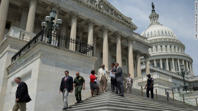 Members of the House of Representatives leave the U.S. Capitol on Friday at the start of their summer recess.