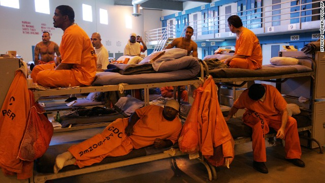 Inmates fill a converted dayroom, which is being used as temporary