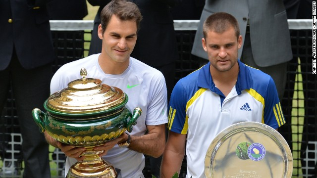 Roger Federer's only title in 2013 came when he beat Mikhail Youzhny, right, in Halle, Germany in June.
