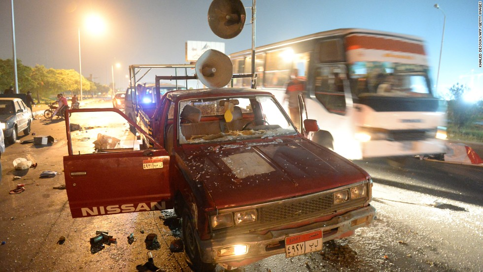 A bus passes a destroyed pickup truck with loudspeakers that was used by supporters of ousted Egyptian President Mohamed Morsy on Friday, August 2. The supporters and security forces clashed in Sixth of October City in Giza, south of Cairo, after the government ordered their protest camps be broken up. <a href='http://www.cnn.com/2013/08/15/middleeast/gallery/egypt-violence-august/index.html' target='_blank'>Look at the latest violence in Egypt.</a>