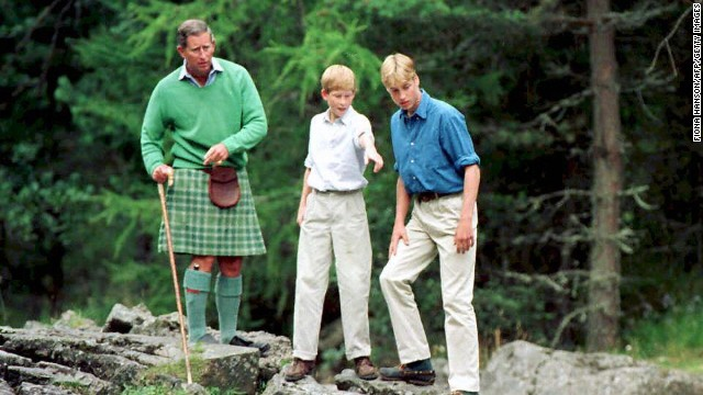 The Prince of Wales, left, and his sons Prince William, right, and Prince Harry stand above the Falls of Muick at Balmoral in 1997.