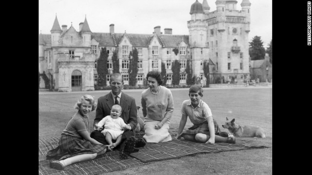 In this September 1960 photo, Queen Elizabeth II and Prince Philip, Duke of Edinburgh pose on the lawn at Balmoral with their children, Prince Andrew, center, Princess Anne, left, and Charles, Prince of Wales.