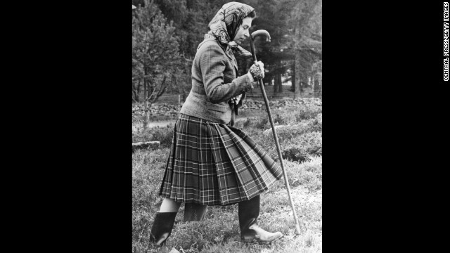 Queen Elizabeth II walks cross country on the grounds of Balmoral Castle in this October 1967 photo.