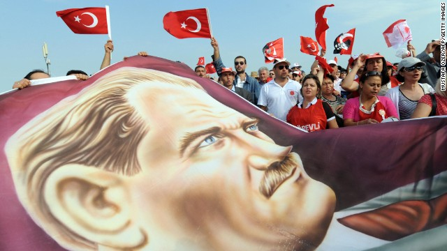 Opponents of the Ergenekon investigation demonstrate with a portrait of Mustafa Kemal Ataturk in Istanbul in 2009.