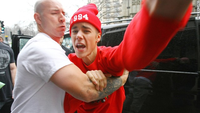 "Bieber and photographers, we've learned by now, don't mix. As he exited the hospital at the end of his turbulent week, the singer got into a shouting match with a paparazzo in London, <a href='http://www.cnn.com/2013/03/08/showbiz/justin-bieber-hospital/index.html' target='_blank'>telling the photographer that he'd ""f*** him up.""</a>"