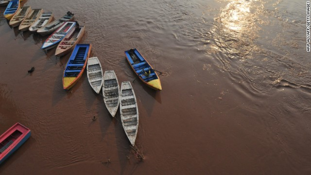 A man prepares to secure his boat on the Ravi River in Lahore, Pakistan, on August 4.<a href='http://www.cnn.com/2013/08/05/world/asia/pakistan-flooding/index.html'> More than 50 people have died</a> in flooding across Pakistan, officials say.