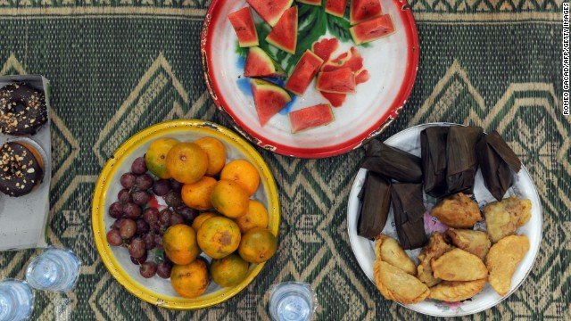 These delicious goodies about to be served to children in a mosque in Jakarta, Indonesia, could be a typical Iftar plate -- the meal eaten to break the fast. It consists of an array of fruits, rice cakes, donuts, tea and water.