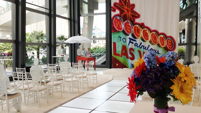 The Pop-Up Wedding Chapel has windows looking out onto to the Vegas strip -- or in at the happy couple! Participants are encouraged to hashtag their adventures on social media with #PopUpChapel.
