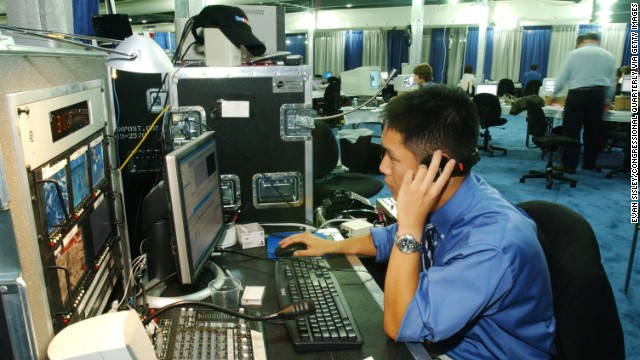 Web producer Dan Jung edits video in the Washington Post newsroom on June 26, 2004. The newspaper launched washingtonpost.com in 1996.
