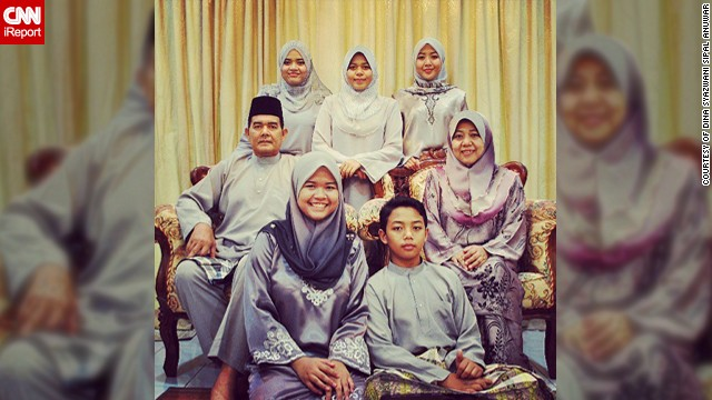 "Dina Syazwani Sipal Anuwar, a 24-year-old teacher from <a href='http://statigr.am/viewer.php#/user/175523476/' target='_blank'>Selangor in Malaysia</a>, took this photo of her family celebrating Eid last year. The photo means a lot to her as it was the last Eid she was able to spend with her father Sipal, a policeman, who unexpectedly passed away in January 2013. It was also the first time the family had ever managed to color coordinate their outfits. ""I think it was one of the signs that father would be leaving us, last Eid we could take a perfect photo as a whole family,"" said Dina, pictured top left. This year the family have decided to all wear pink."