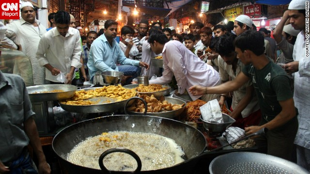 The hustle and bustle of the Matia Mahal bazaar close to Old Delhi's principal mosque Jama Masjid was captured on film by 70-year-old Ramesh Lalwani. The samosas are in the process of being fried and the pakoras, jalebis and gulab jamuns are ready for sale to the Eid crowds.