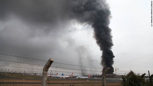 Heavy smoke rises from the airport's main building on August 7.