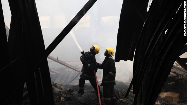 Firefighters work to put out the blaze on August 7.