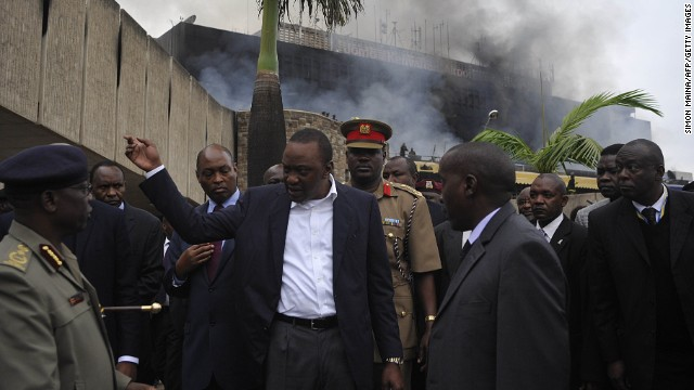 Kenyan President Uhuru Kenyatta visits the Nairobi airport on August 7 to check out the damage. The blaze could have a huge impact on Kenya's tourism and commerce.